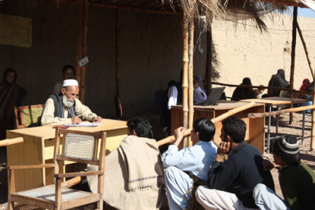 People registering in the camp - once registered they receive food