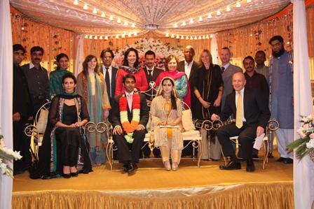 Imran and his new wife Samra surrounded by OCHA staff