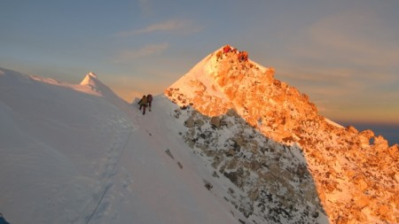 Summit illuminated by the rising sun