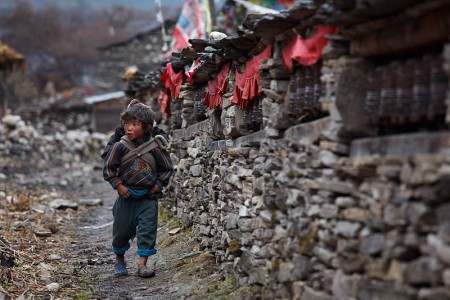 Small child walking in Samagaon near Manaslu